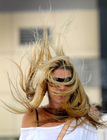 Amy Kechter of San Diego doesn't let the gusty winds bother her as she walks along a bridge at CityCenter on Monday. (David Becker/Las Vegas Review-Journal)