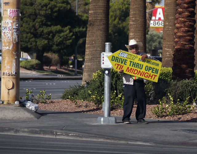 A Subway sign holder, who declined to give his name, finds his job extra difficult in the high winds at the corner of Sahara Avenue and Decatur Boulevard in Las Vegas, Monday, Oct. 28, 2013. Winds ...