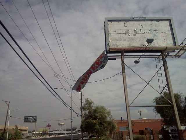 Vinyl is blown off a billboard on J Street and Bonanza Rd. (Courtesy Alex Peralez)