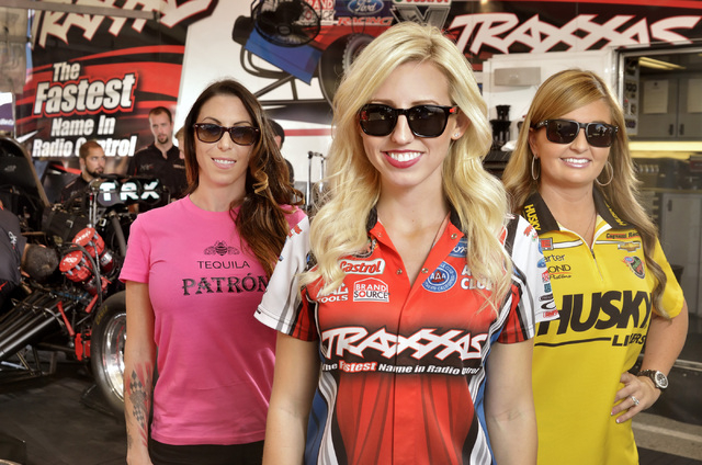Posing in the pit area of the drag strip at Las Vegas Motor Speedway at 6925 Speedway Blvd. on Friday, Oct. 25, 2013, are, from left, Alexis DeJoria, Courtney Force and Erica Enders-Stevens. (Bill ...