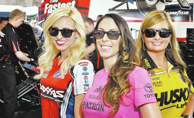Posing in the pit area of the drag strip at Las Vegas Motor Speedway at 6925 Speedway Blvd. on Friday, Oct. 25, 2013, are, from left, Courtney Force, Alexis DeJoria and Erica Enders-Stevens. (Bill ...