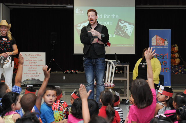 WWE Superstar Sheamus interacts with children during a book reading at Gragson Elementary School in Las Vegas Thursday, Oct. 3, 2013.  Jumpstart's Read for the Record is a world-record-breaking ca ...