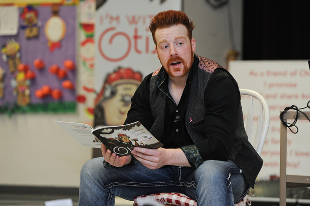 "WWE Superstar Sheamus reads the book ""Otis"" to children at Gragson Elementary School in Las Vegas Thursday, Oct. 3, 2013.  Jumpstart's Read for the Record is a world-record-breaking campaign that  ..."