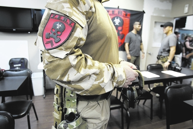 A Zombie Eradication Response Team member who declined to give his name prepares for a pistol class at American Shooters at 3440 Arville St. in Las Vegas Friday, Aug. 20, 2013. Z.E.R.T. is a world ...