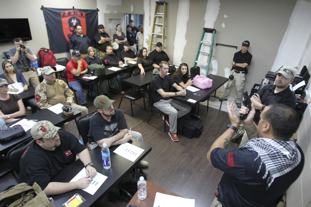 Zombie Eradication Response Team Chief Executive Officer Aaron Mauldin leads a pistol class at American Shooters at 3440 Arville St. in Las Vegas Friday, Aug. 20, 2013. Z.E.R.T. is a worldwide org ...