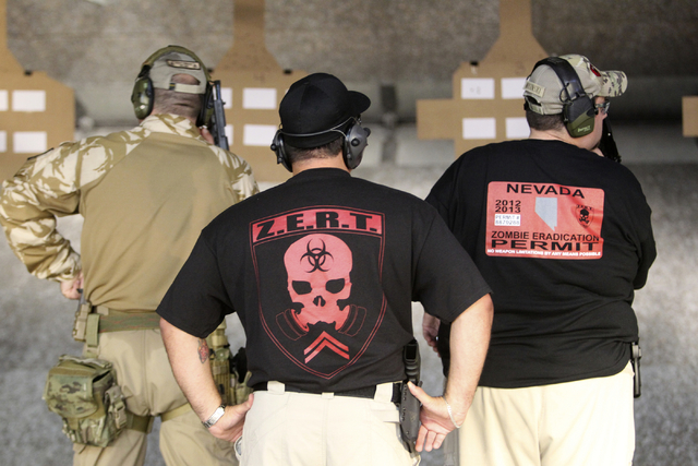 Zombie Eradication Response Team members prepare to shoot during a pistol class at American Shooters at 3440 Arville St. in Las Vegas Friday, Aug. 20, 2013. Z.E.R.T. is a worldwide organization ba ...