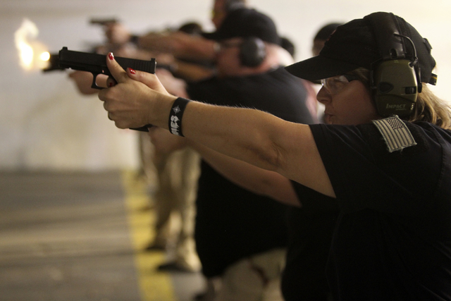 Zombie Eradication Response Team member Alexandra Nikolov shoots during a pistol class at American Shooters at 3440 Arville St. in Las Vegas Friday, Aug. 20, 2013. Z.E.R.T. is a worldwide organiza ...