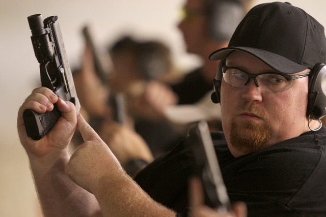 Zombie Eradication Response Team member Andy Sensi prepares to shoot during a pistol class at American Shooters at 3440 Arville St. in Las Vegas Friday, Aug. 20, 2013. Z.E.R.T. is a worldwide orga ...