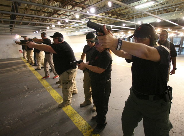 Zombie Eradication Response Team member Alexandra Nikolov, right, and fellow members shoot during a pistol class at American Shooters at 3440 Arville St. in Las Vegas Friday, Aug. 20, 2013. Z.E.R. ...