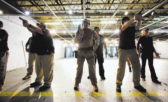 Zombie Eradication Response Team members shoot during a pistol class at American Shooters at 3440 Arville St. in Las Vegas Friday, Aug. 20, 2013. Z.E.R.T. is a worldwide organization based in Las  ...