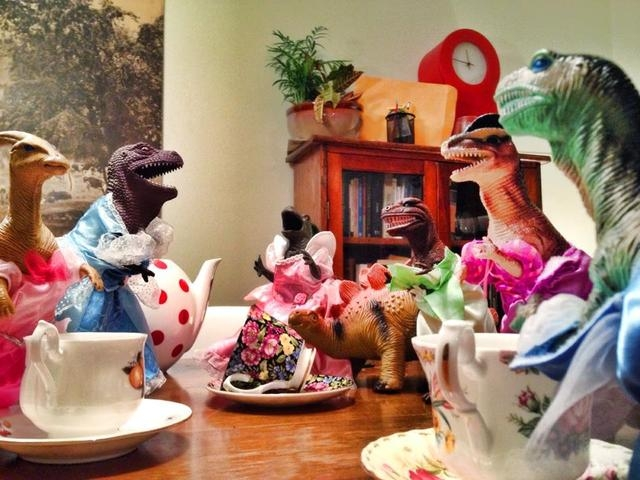 """""""Rex had found the perfect dress for the party."""" Susan and Refe Tuma dedicate the month of November every year to making their children believe their toy dinosaurs come to life at night. (Dinovemb ..."""
