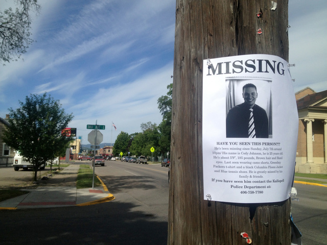 This July 12, 2013 photo, a flyer seeking information regarding Cody Lee Johnson is posted on a Kalispell, Mont., street corner. Johnson's newlywed wife, Jordan Graham, testified Friday that she i ...