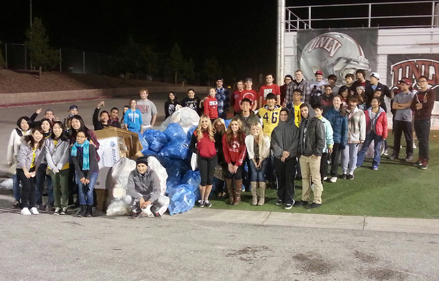 Volunteers from UNLV pose with the recyclables they collected during the Rebels' Nov. 2 Homecoming football game at Sam Boyd Stadium. Their efforts were enough to land them in the top seven in sev ...