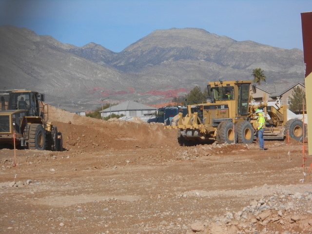 Construction crews grade the nearly 20-acre parcel on the northeast corner of Sahara Avenue and Hualapai Way, Nov. 6. The site is set to house Sahara Center, a retail development being built by a  ...