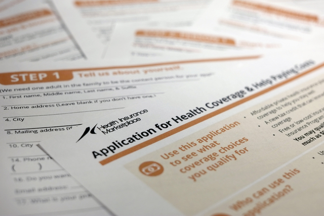 This Sept. 11, 2013, file photo, shows the federal government form for applying for health coverage in Washington. (AP Photo/J. David Ake, File)