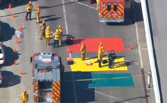 In this aerial video frame grab provided by CBS-LA, fire and rescue personnel gather at Los Angeles International Airport on Friday Nov. 1, 2013. Shots were fired Friday at Los Angeles Internation ...