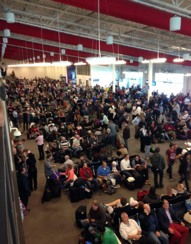 In this photo provided by Tory Belleci which has been authenticated based on its contents and other AP reporting, people wait in Los Angeles International Airport, Friday, Nov. 1, 2013.  Shots wer ...