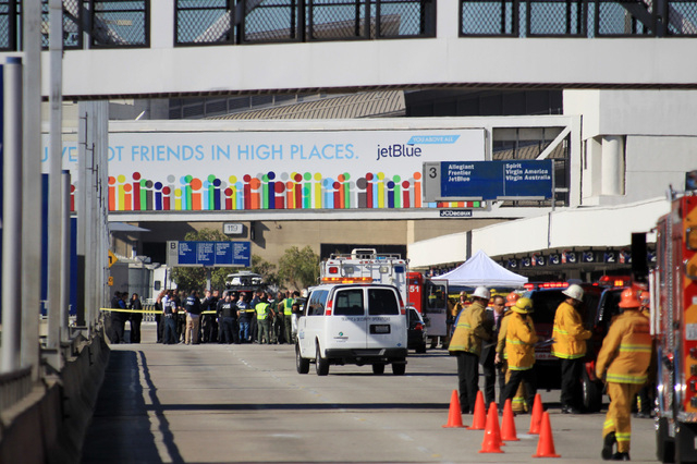 Fire, rescue and police personnel gather at the Los Angeles International Airport on Friday Nov.1, 2013. Shots were fired Friday at Los Angeles International Airport, prompting authorities to evac ...