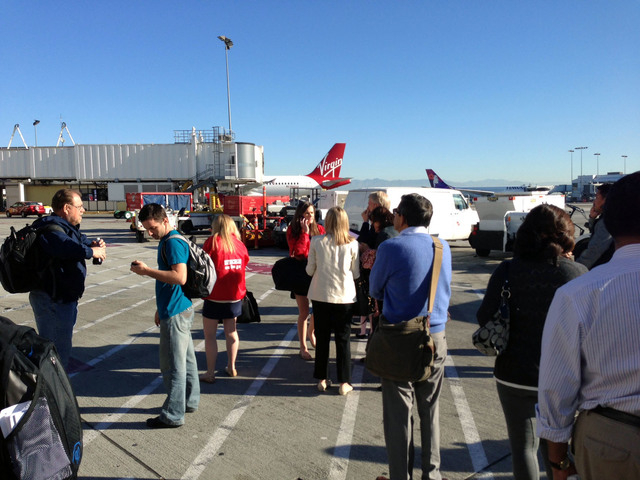 In this photo provided by John Forstrom, which has been authenticated based on its contents and other AP reporting, people wait on the tarmac at Los Angeles International Airport, Friday, Nov. 1,  ...