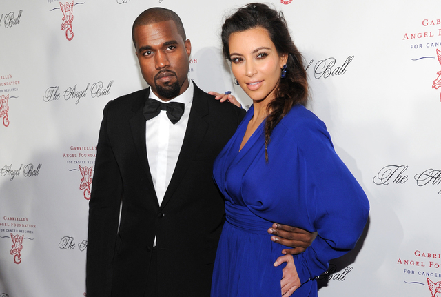 Singer Kanye West, left, and girlfriend Kim Kardashian attend Gabrielle's Angel Foundation 2012 Angel Ball cancer research benefit at Cipriani Wall Street in New York.  (Photo by Evan Agostini/Inv ...