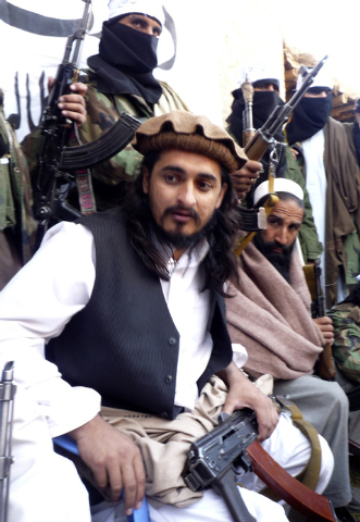 In this file image taken on Nov. 26, 2008, Hakimullah Meshud, then the deputy Pakistani Taliban leader, is flanked by his comrades in Orakzai tribal region of Pakistan. Intelligence officials said ...