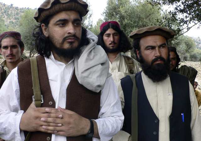 In this Oct. 4, 2009 file photo, Pakistani Taliban chief Hakimullah Mehsud, left, is seen with his comrade Waliur Rehman during his meeting with media in Sararogha, a Pakistani tribal area of Sout ...