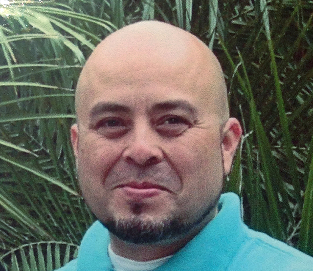 This June, 2013 photo released by the Hernandez family Saturday, Nov. 2, 2013, shows Transportation Security Administration officer Gerardo Hernandez.  Hernandez, 39, was shot to death and several ...
