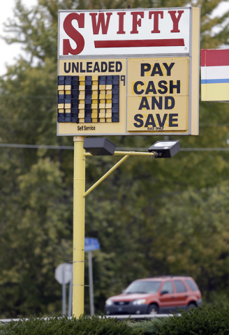 A Swifty gas station in Kokomo, Ind., advertises a discount for cast as gas sold for $3.17 in Kokomo, Ind., Thursday, Oct. 24, 2013. Local gasoline prices are swinging up and down ever more drasti ...