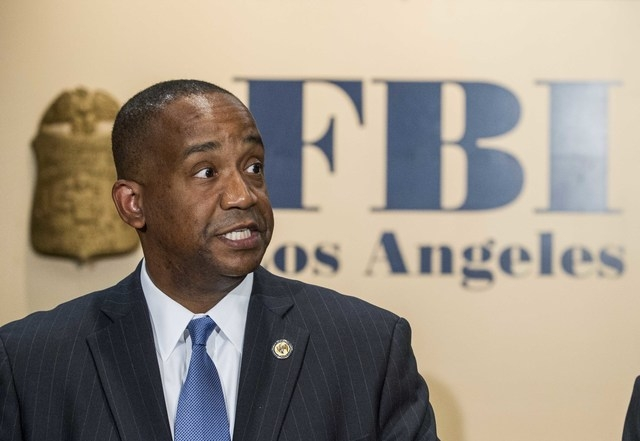 United States Attorney Andre Birotte Jr. speaks in press conference to provide an update on the investigation of the shooting incident at Los Angeles International Airport (LAX), on Saturday Nov.  ...