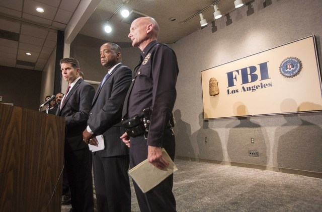 From left to right, FBI Special Agent in Charge David L. Bowdich, United States Attorney Andre Birotte Jr., and Los Angeles Police Department Commander Andrew Smith in press conference to provide  ...