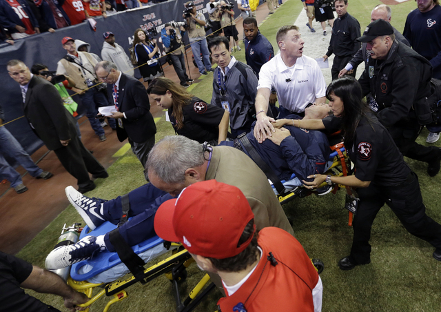 Houston Texans head coach Gary Kubiak is taken off the field on a stretcher during the second quarter of an NFL football game against the Indianapolis Colts, Sunday, Nov. 3, 2013, in Houston. (AP  ...