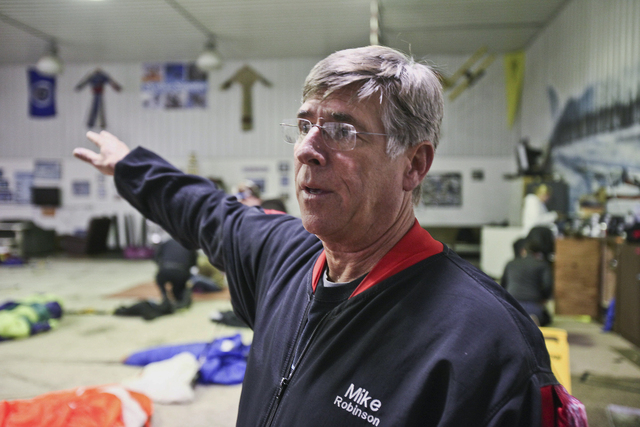Mike Robinson, an instructor and safety adviser for Skydive Superior, describes the circumstances that caused a Cessna 185 and a Cessna 182 to collide in midair Saturday, Saturday evening, Nov. 2, ...