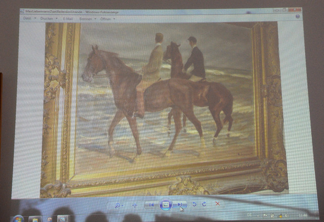 """A painting from Max Liebermann """"Zwei Reiter am Strande"""" (""""Two riders on the beach"""") is projected on a screen during a news conference in Augsburg, southern Germany, Tuesday, No ..."""