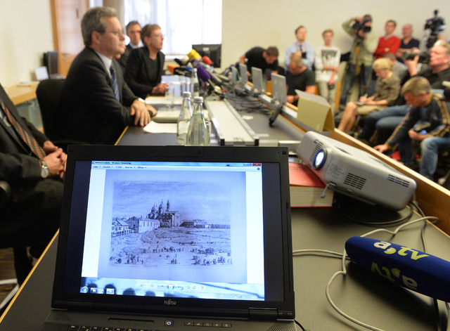 An artwork of Antonio Canaletto is shown on a computer screen during a news conference in Augsburg, southern Germany, Tuesday, Nov. 5, 2013, on the art found in Munich. A hoard of more than 1,400  ...