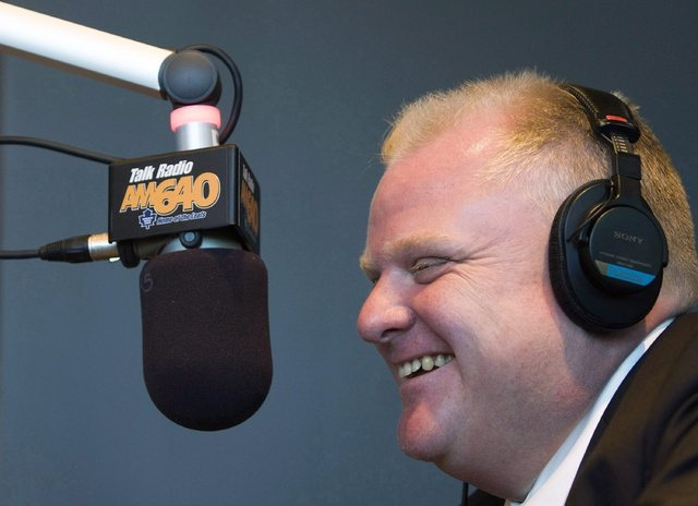 FILE -- In this Oct. 27, 2010, file photo, then newly elected Toronto mayor Rob Ford speaks on-air at Talk Radio AM 640 with host John Oakley in Toronto. Embattled Ford repeated Saturday, Nov. 2,  ...
