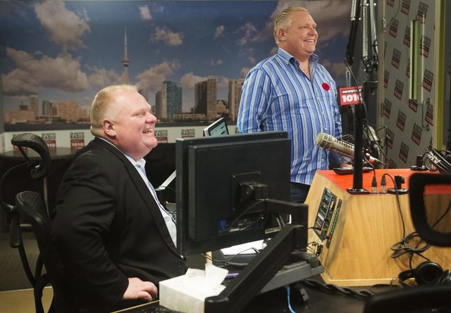 Toronto Mayor Rob Ford and his brother, Toronto city councillor Doug Ford, right, appear on a radio show in Toronto, Sunday, Nov. 3, 2013. (AP Photo/The Canadian Press, Mark Blinch)