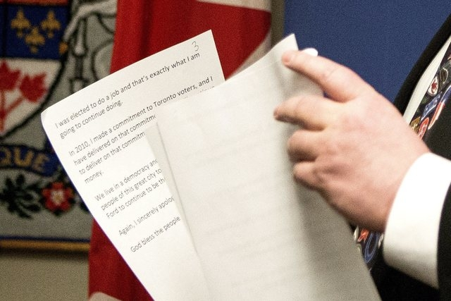 """Toronto Mayor Rob Ford holds his notes after addressing media at City Hall in Toronto, Tuesday, Nov. 5, 2013.  Ford acknowledged for the first time that he smoked crack """"probably a year ago,& ..."""