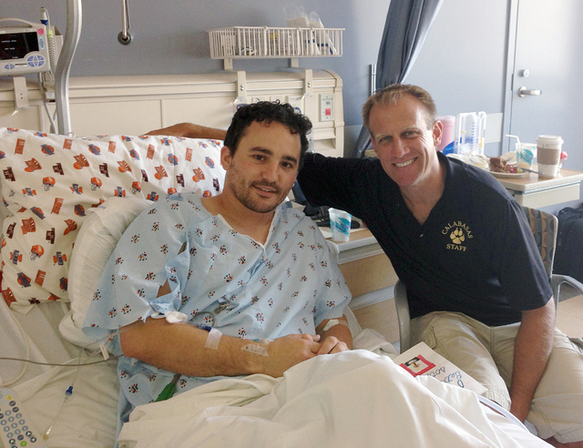 In this Sunday, Nov. 3, 2013 photo provided by his mother Judy Ludmer, Brian Ludmer, left, the Calabasas High School teacher who was wounded in the Los Angeles International Airport shootings on N ...