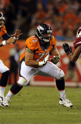 Denver Broncos guard John Moffitt plays against the Arizona Cardinals  during a pre-season NFL football game on Thursday, Aug. 29, 2013, in Denver. Moffitt says he quit the NFL this week not becau ...