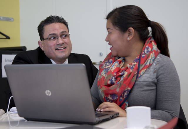 Principal Jorge Delgado talks with student Ana Rodriguez-Perez, right, during a General Educational Development (GED) test preparation class at the Sonia Gutierrez Campus of the Carlos Rosario Int ...