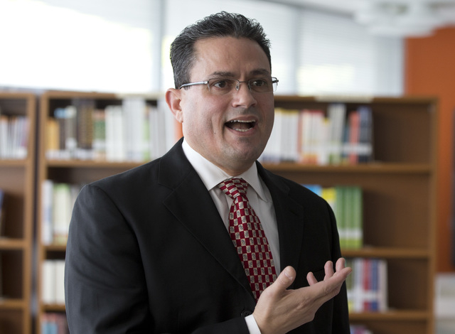 Principal Jorge Delgado speaks during an interview at the Sonia Gutierrez Campus of the Carlos Rosario International Public Charter School on Oct. 22, 2013, in Washington. Americans who passed par ...