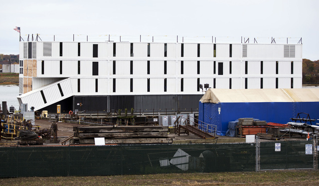 A four-story structure rests on top of a barge Friday, Nov. 1, 2013, in Portland Harbor, in Portland, Maine. It is one of three secretive structures that have online speculation focused on Google. ...