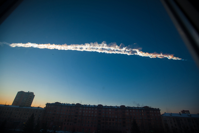 In this Feb. 15, 2013 file photo provided by Chelyabinsk.ru, shows a meteorite contrail over the Ural Mountains' city of Chelyabinsk, about 930 miles east of Moscow, Russia. After a surprise meteo ...