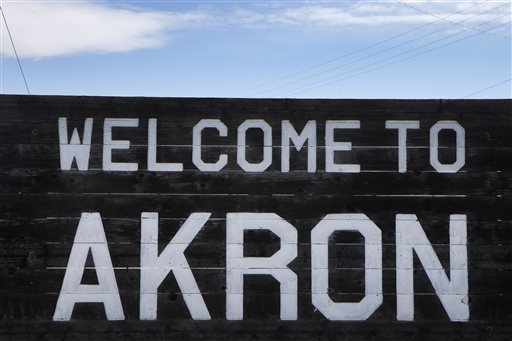 In this Nov. 6, 2013 photo, a sign welcomes visitors to the rural town of Akron, the county seat of Washington County, Colo. A day earlier, a majority in Washington and four other counties on Colo ...