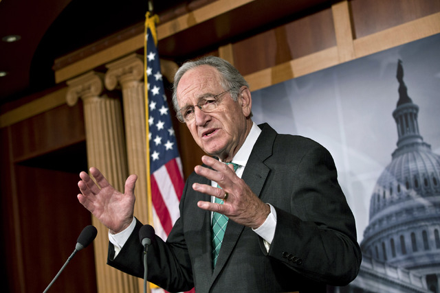 Sen. Tom Harkin, D-Iowa, chairman of the Health, Education, Labor, and Pensions Committee, talks to reporters after the Senate cleared a major hurdle and agreed to proceed to debate a bill that wo ...