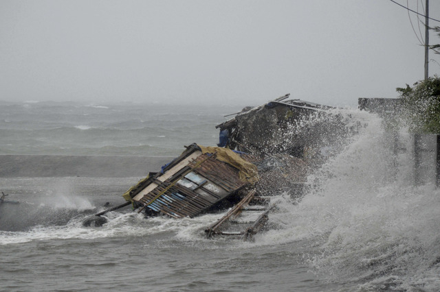 A house is engulfed by the storm surge brought about by powerful typhoon Haiyan on Friday that hit Legazpi city, Albay province about 325 miles south of Manila, Philippines. Typhoon Haiyan, one of ...