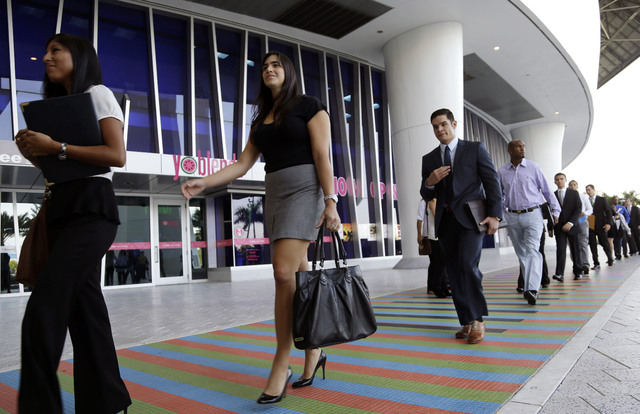 In this Wednesday, Oct. 23, 2013, file photo, job applicants arrives for an internship job fair held by the Miami Marlins, at Marlins Park in Miami. The government issues the October jobs report,  ...