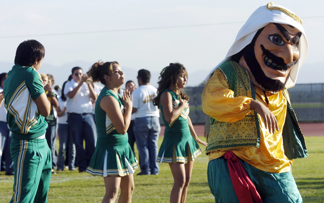 "In this Nov. 10, 2005 photo, Coachella Valley High School's mascot, ""Arab,"" dances to the band during a pep rally at the school in Thermal, Calif.  The American-Arab Anti-Discrimination Committee  ..."