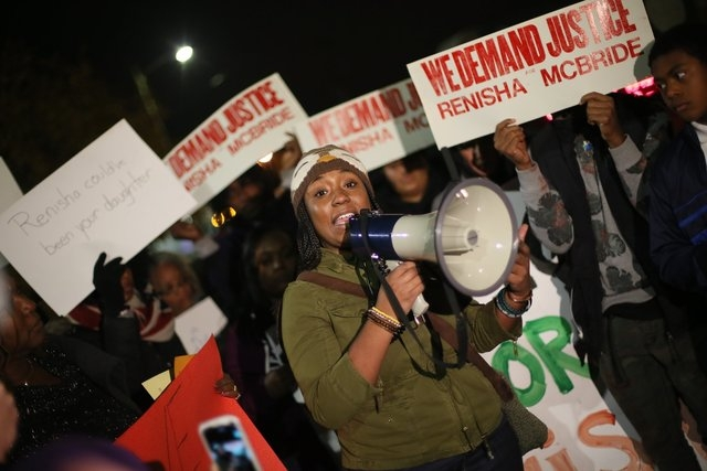 Siwatu-Salama Ra, 22, of Detroit speaks to the crowd during a rally to protest the shooting death of Renisha McBride at the Dearborn Heights Justice Center on Thursday, Nov. 7, 2013. (AP Photo/Det ...