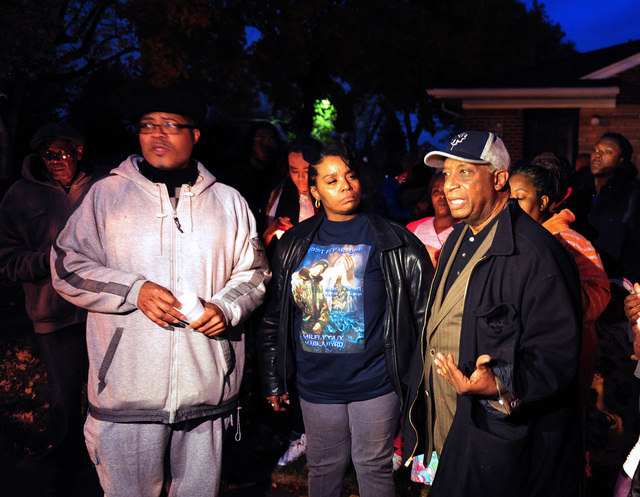 Pastor W. J. Rideout, Renisha McBride's aunt Bernita Spinks and Ron Scott speak to the media during a vigil  in Dearborn Heights, Mich., for Renisha McBride in the front of the home where she shot ...